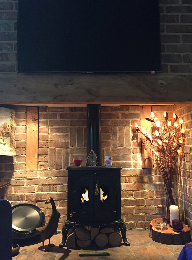 Old Woodburner With A Bio Fuel Insert In An Inglenook
